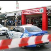 Three suspects are still at large after shooting two guards and injuring a customer at Spar.
