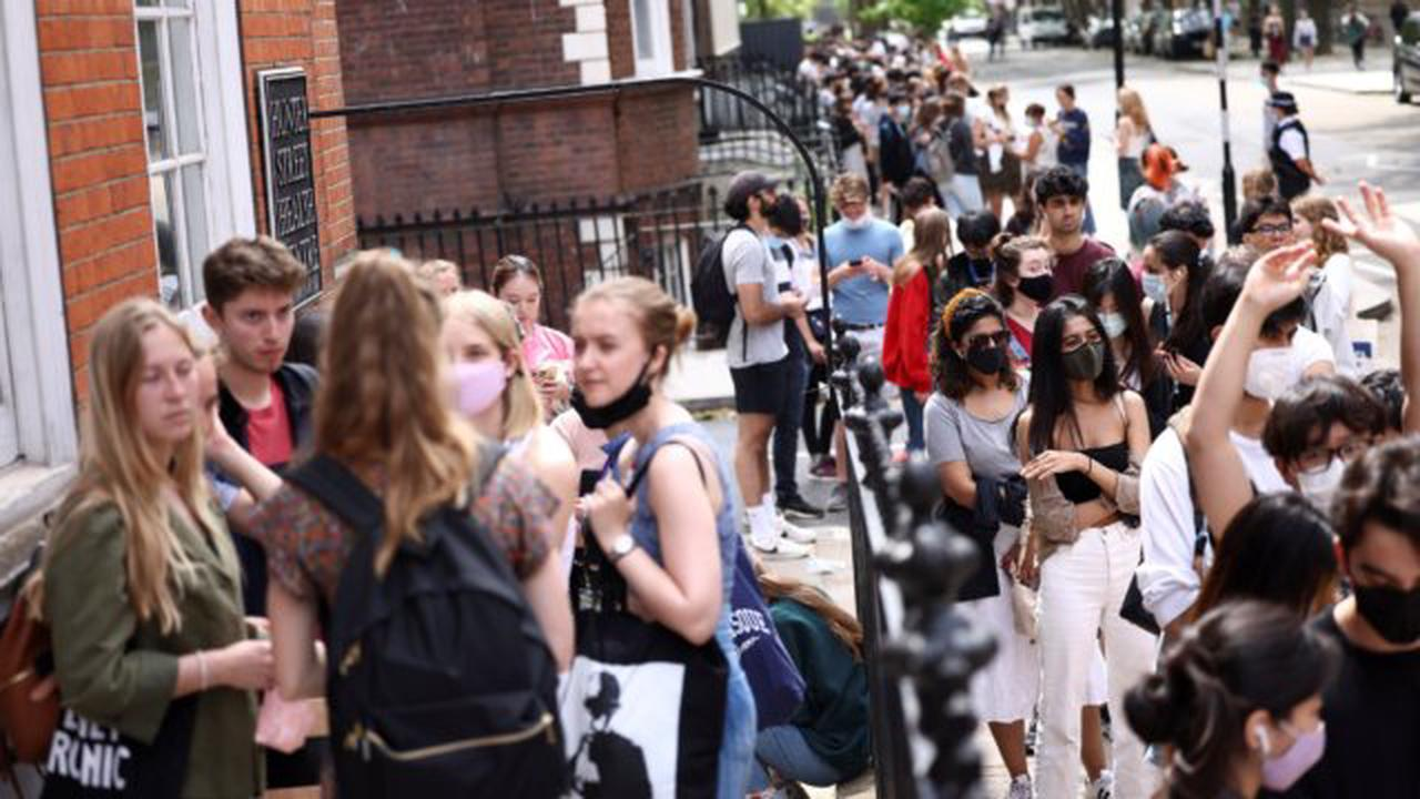 Over 18s queue to receive Covid vaccine after flocking to jab centre