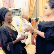 Reactions As Bobrisky Shares Video OF Him Spraying An Old Woman Money In His House On Instagram