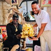 King Ateke Tom reacts after singer Mr 2Kay presented this gift to him at his palace