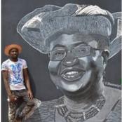 A Young Artist Paints The Portrait Of Okonjo Iweala On A Street Wall