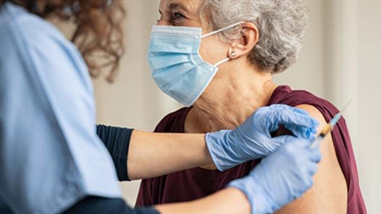 Booster vaccine drive will begin next month: ALL over-50s will get invites for third dose 'alongside their annual flu jab'
