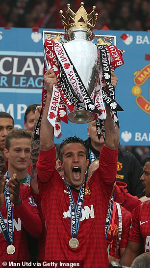 Van Persie lifts the Premier League title with Manchester United in 2013