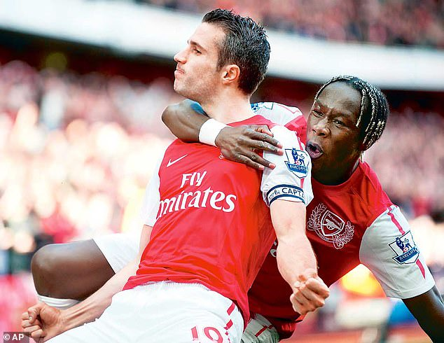 Bacary Sagna (right) celebrates with Robin van Persie during a game against Spurs in 2012