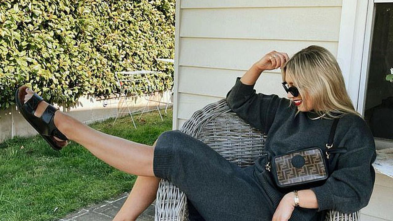 Former WAG Phoebe Burgess debuts a new 'transeasonal look' worth nearly $35,000 as she relaxes on the porch at her parents' Bowral home