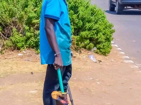 Ability in disability: One legged man who cleans car windscreen on the road side to earn a living.