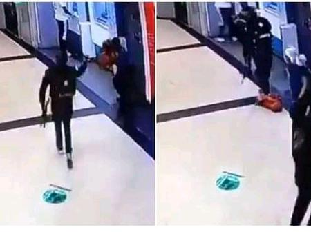 Security Man Stylishly Vanishes As Armed Robbers Storm And Rob A Store