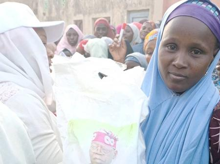 Check Out How These Three Nigerians Reacted After Tinubu-Branded Rice Is Shared To Residents In Kano