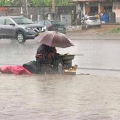 Despite The Heavy Rainfall, See What This Nursing Mother Was Spotted Doing Which Caused Reactions
