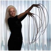 Woman with longest fingernails demonstrates How she does her chores.