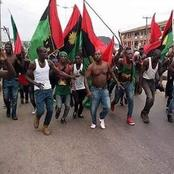 Gunmen Carrying Biafra Flags Attacked A Bank In Anambra And Destroyed Vehicles In The Premises