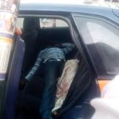 A lifeless body of taxi driver seen inside the back seat of his own car in Kumasi-Breman.