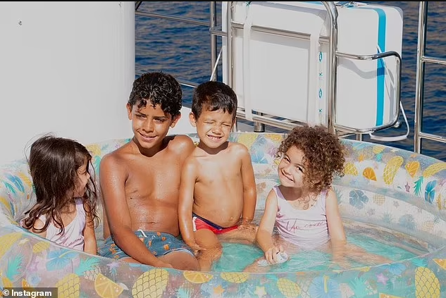 Shirtless Cristiano Ronaldo relaxes in the sun with girlfriend Georgina Rodriguez and his children during boat trip in Majorca (photos)