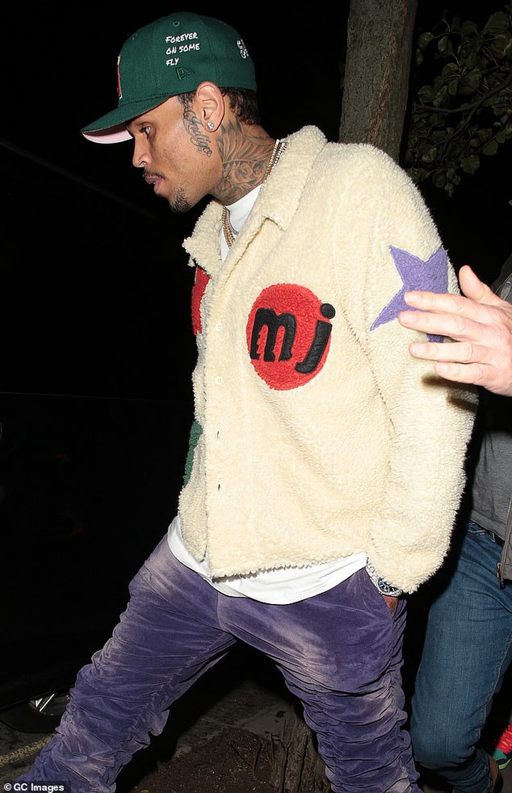 Chris Brown spotted with rumored girlfriend Gina Huynh during night out in London ?(photos)