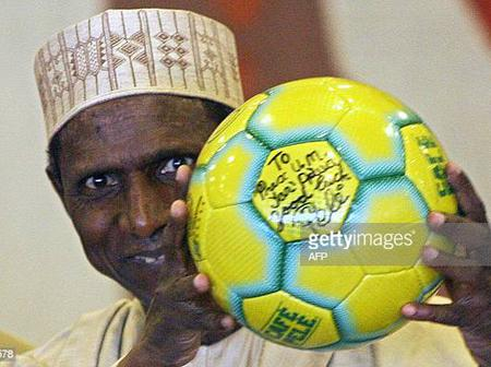 Photos of Yar Adua holding a ball with a beaming smile