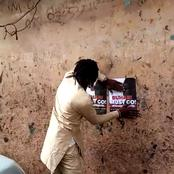 See What This Young Man Was Spotted Pasting On The Wall In Benin City That Could Get Him In Trouble