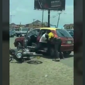 Mixed Reactions On Twitter As A Bike Rider Was Spotted In A Fight With A Taxi Driver
