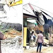 TLB's are busy demolishing houses and Shacks that are built along road sidewalk.