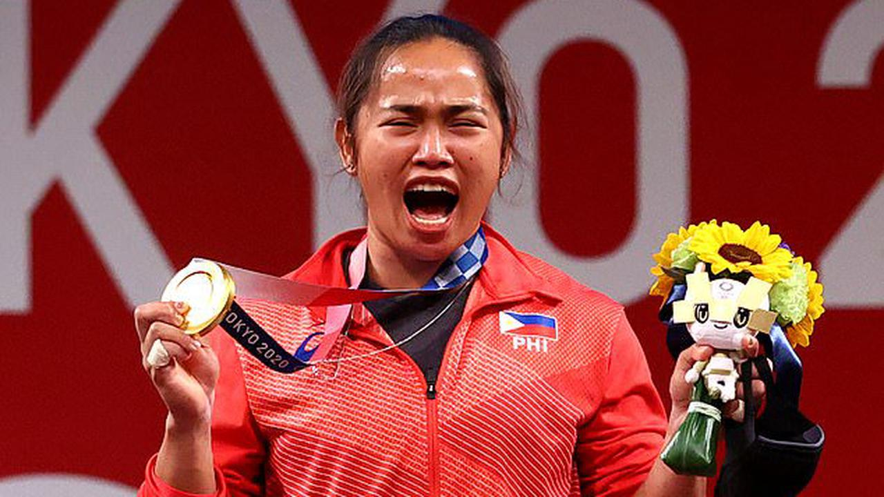 97 YEARS in the making! Philippines win their first EVER Olympic gold medal as weightlifter Hidilyn Diaz dominates women's 55kg - before breaking down into tears