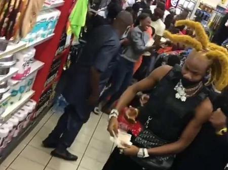 VIDEO: Alleged Yahoo Boy Shuts Down Shopping Mall Spraying Dollars In Lagos