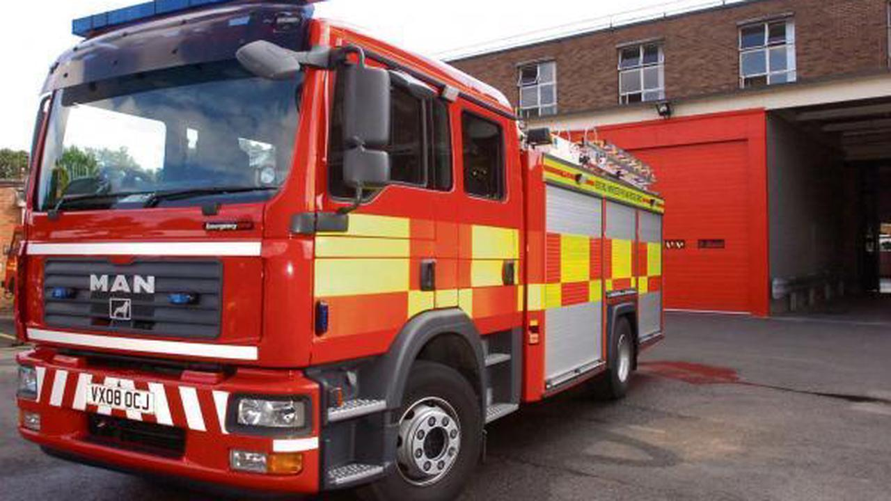 Six fire crews battle huge blaze inside roof space of two properties
