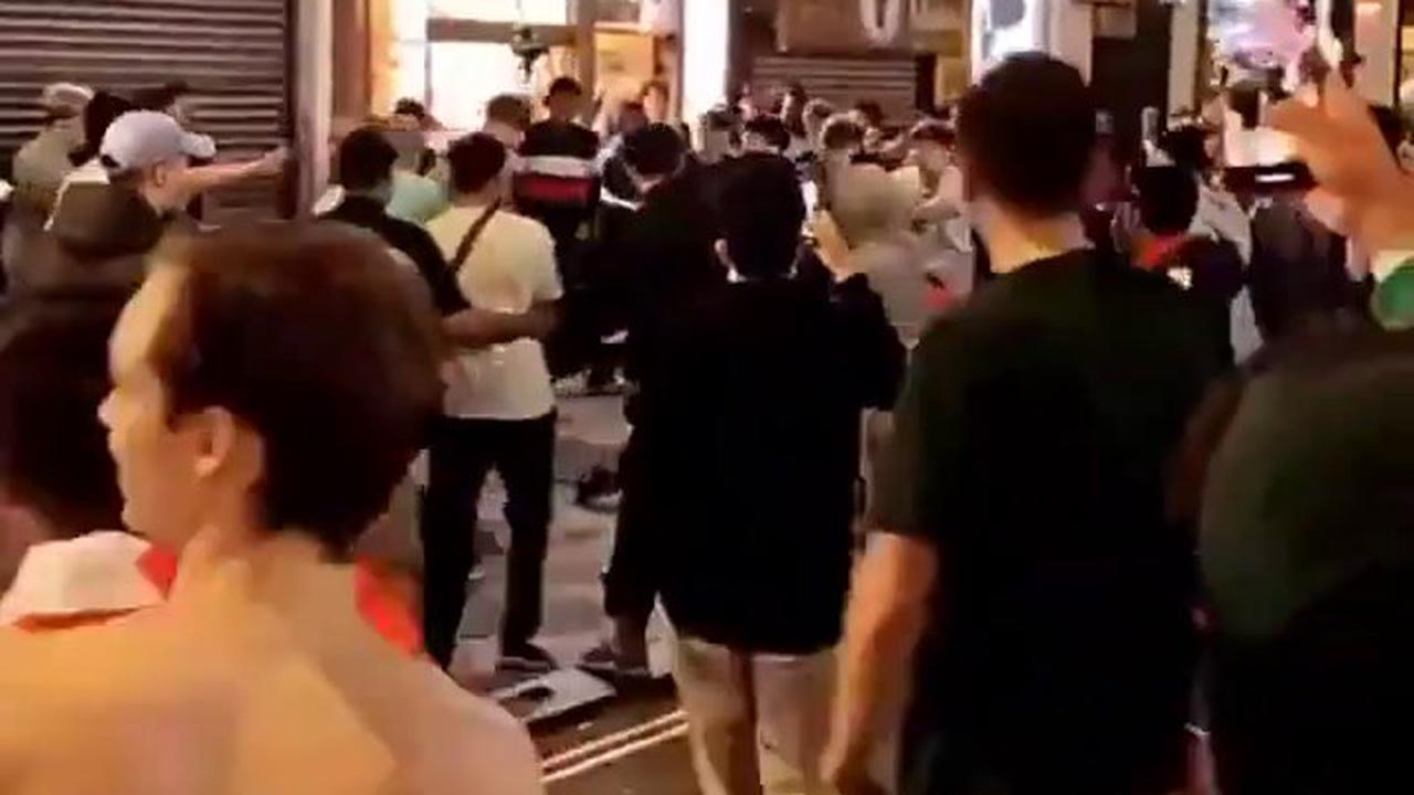 Watch moment drunk England fans brawl in street and supporter is thrown to floor