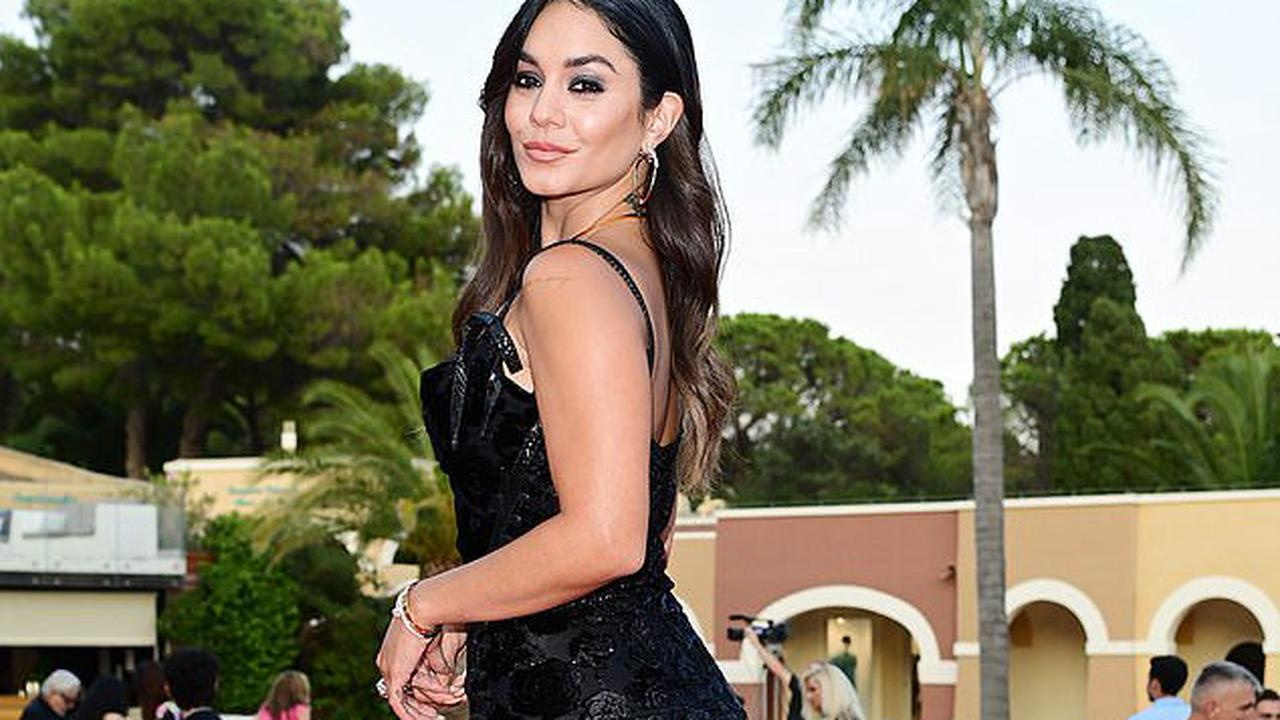 Vanessa Hudgens puts on a VERY leggy display in a glitzy black dress featuring a perilously high split as she attends the Filming Italy Festival