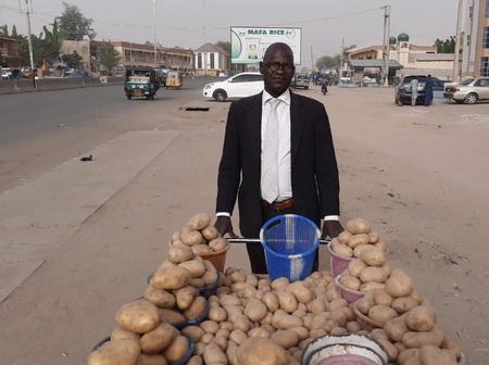 Reactions As Man Wore Suit And Tie To Sell Potatoes In Kano