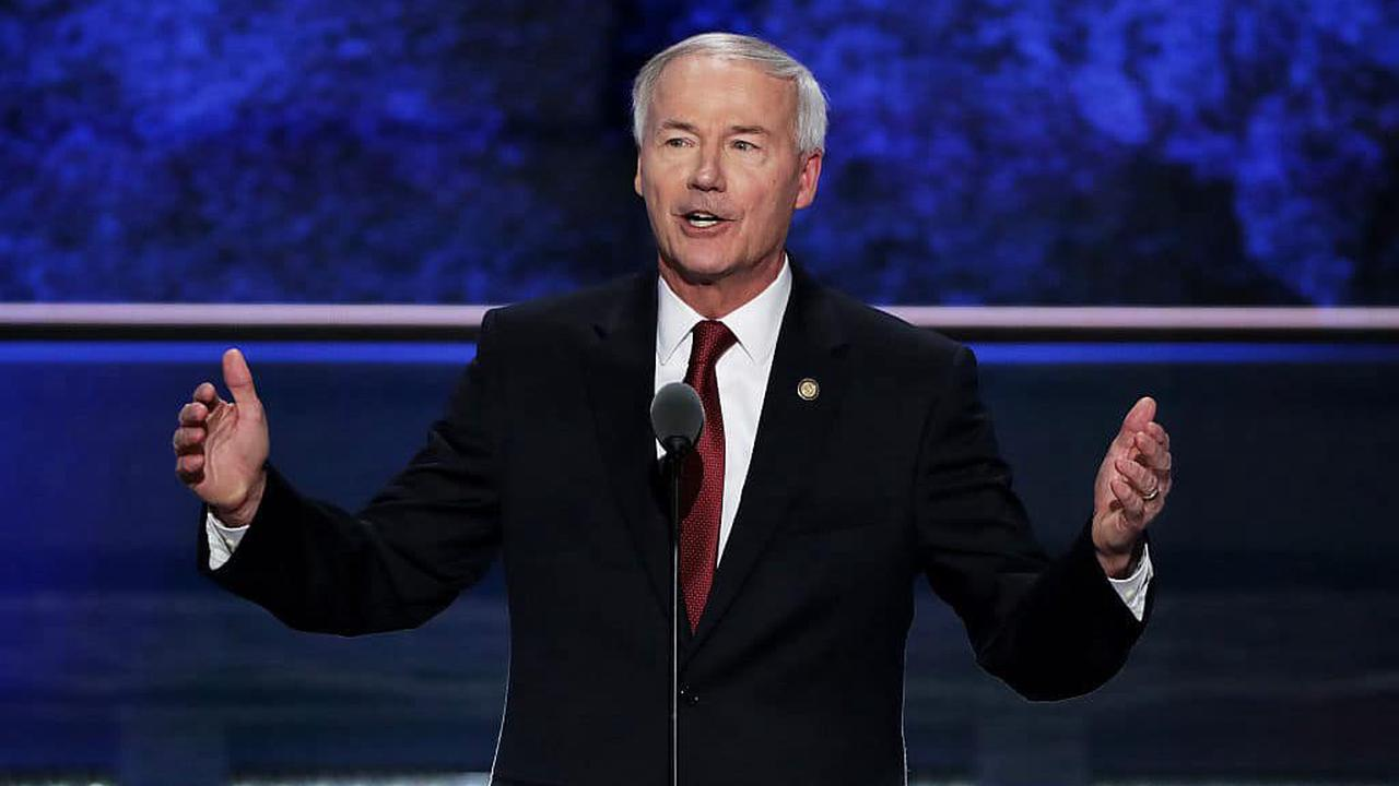 Arkansas governor apologises to trans youth after 'extreme' healthcare ban forced through
