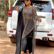 Destiny Etiko looks so beautiful standing in front of her white car (See photos)