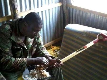 Netizens React After This Photo of GSU Officer Eating On A Shovel Went Viral