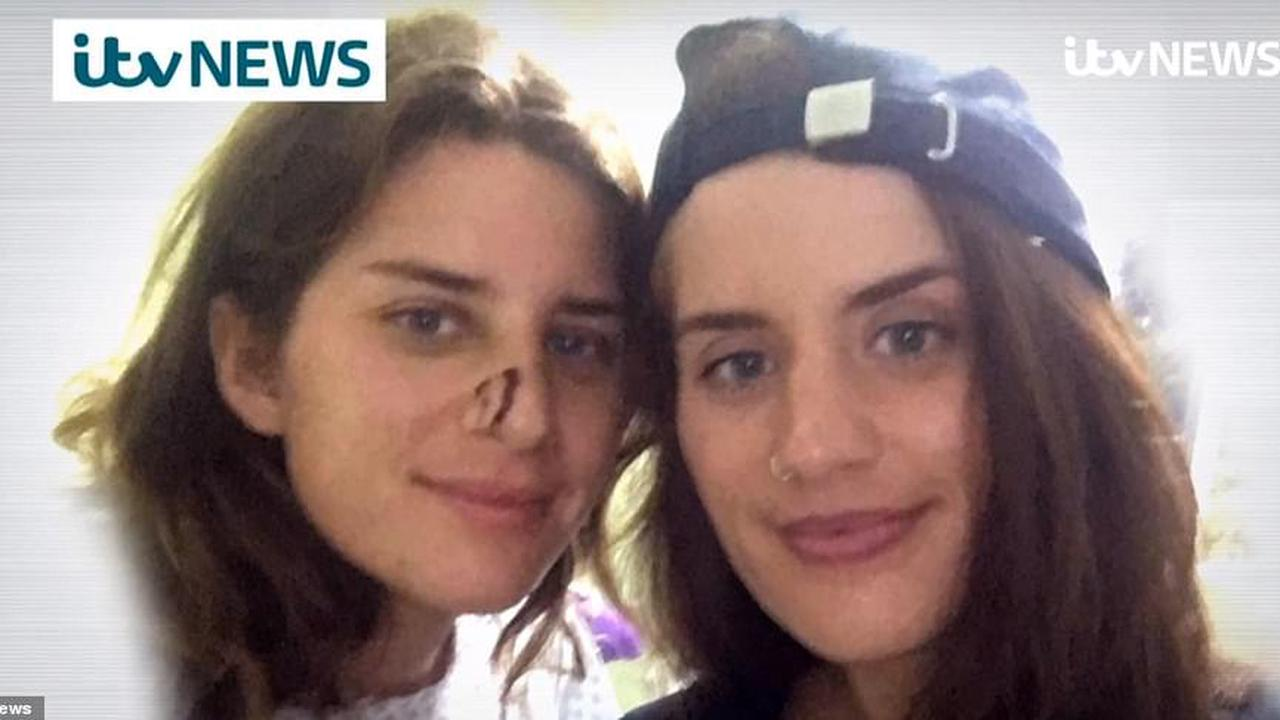 Pictured for the first time AFTER crocodile attack: Twins who survived lagoon horror are seen in hospital as one sister says 'I thoughts she was dead' when beast attacked her sibling