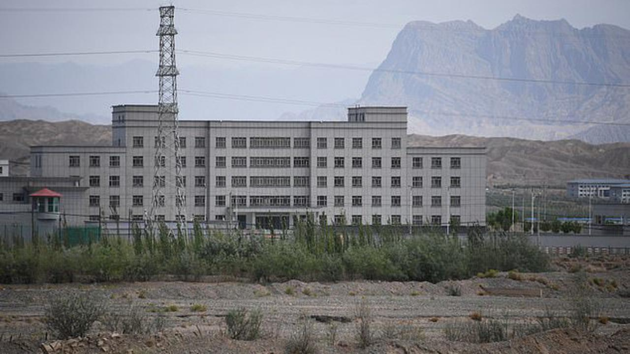 China's largest prison where 10,000 inmates are tortured with cattle prods