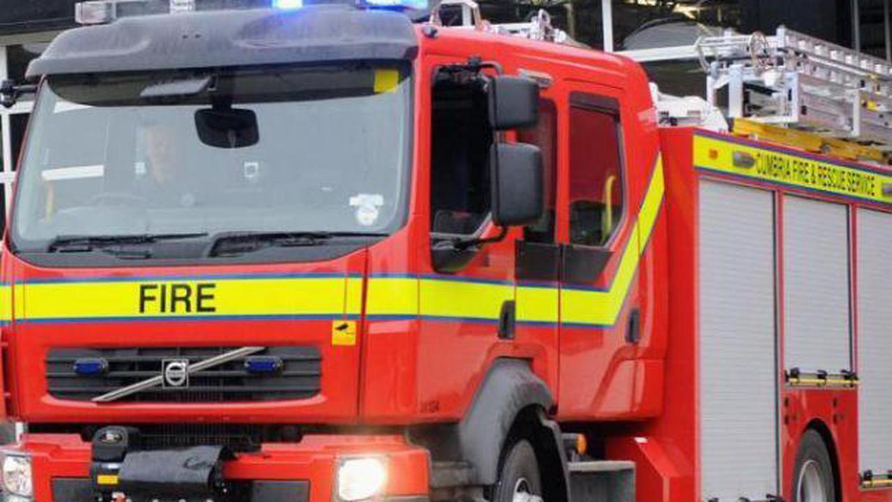 Carlisle firefighters help unconscious patient on pavement