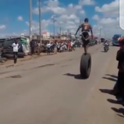 Is This Jazz? This Little Boy Was Seen Ridding A Tyre With His Two Legs On Top