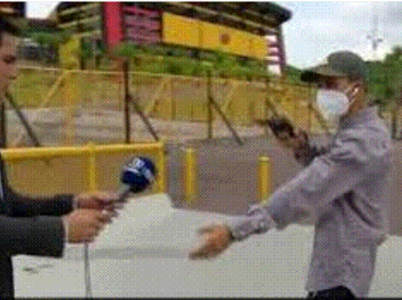 Robber Robs Journalist At Gunpoint During Live Report.
