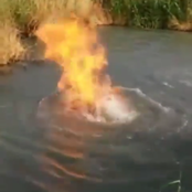 People react to the fire that is burning right inside the river.