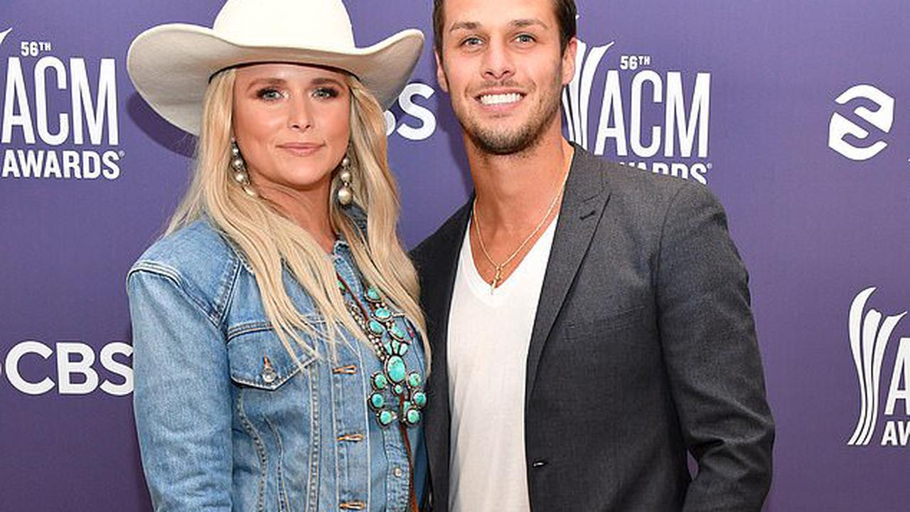 Miranda Lambert goes full-on cowgirl in triple denim and white Stetson as she poses with Brendan McLoughlin at ACM Awards in Nashville