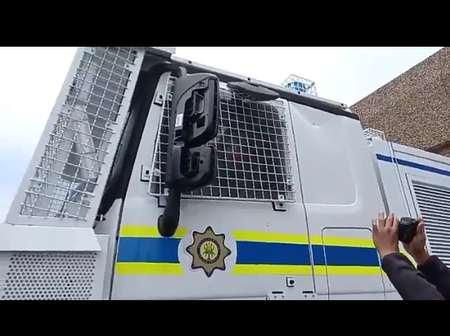 Lindiwe Zulu Addresses Citizens At SASSA Offices Inside Armoured Police Vehicle