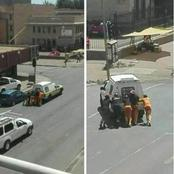 Prisoners Helping Police with their broken down vehicle.