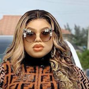 Bobrisky Stuns In Body Fitted Jumpsuit and Handbag, Shares Photos