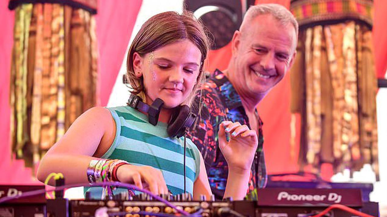 DJ Fatboy Slim's daughter Nelly, 11, follows in his musical footsteps as she gets behind the decks at Camp Bestival