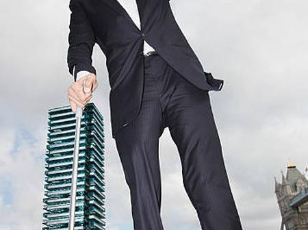 Meet The WORLD'S TALLEST Man Standing close to a bridge