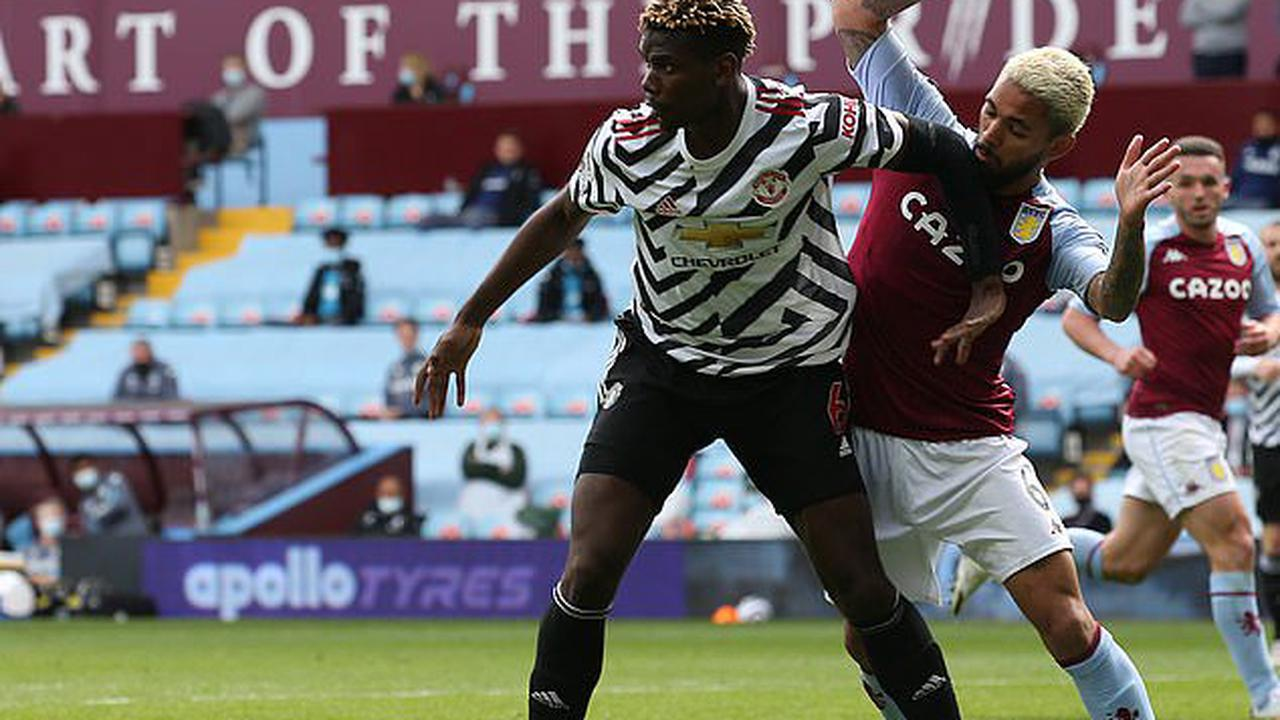 Dean Smith slams 'pathetic' decision to award Manchester United a penalty after a challenge on Paul Pogba
