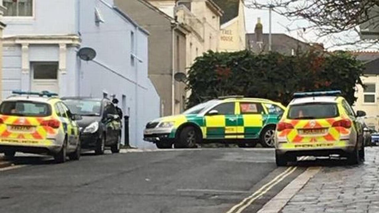 Woman who died at Plymouth flat closed by police is named