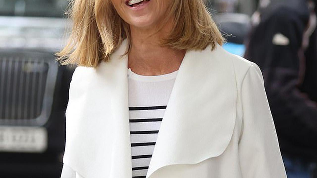Kate Garraway keeps smiling as she leaves radio in striped jumper and white coat following her big NTA win