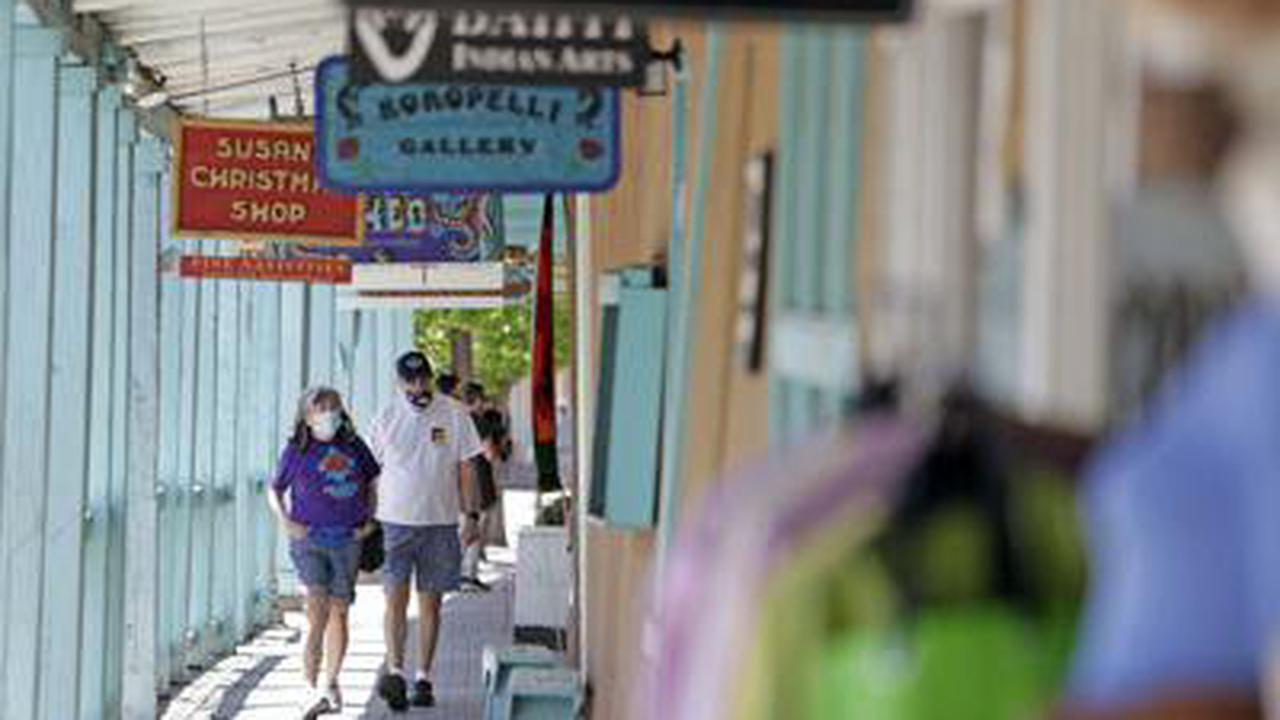In Santa Fe, loosened mask guidelines met with mixed reaction