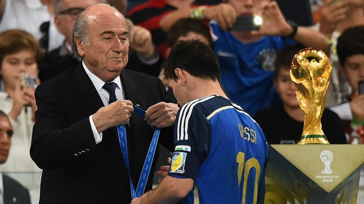 Messi receives his silver medal from Blattter at 2014 world cup (Photo Credit: Goal)