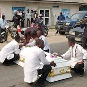 Tears flow as man who returned from abroad for Christmas and was shot in his shop gets buried.