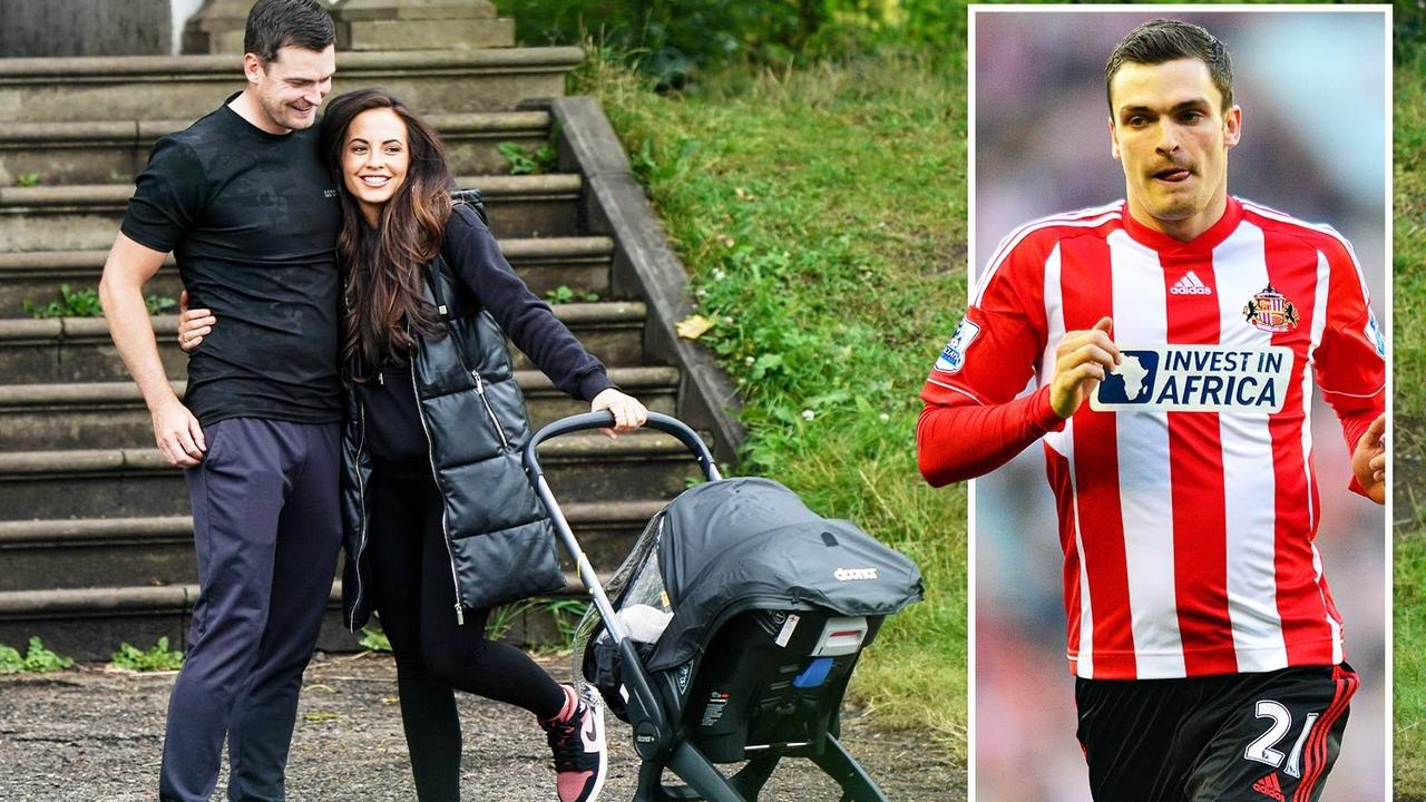 Disgraced footballer Adam Johnson and his girlfriend take daughter and newborn son for a walk